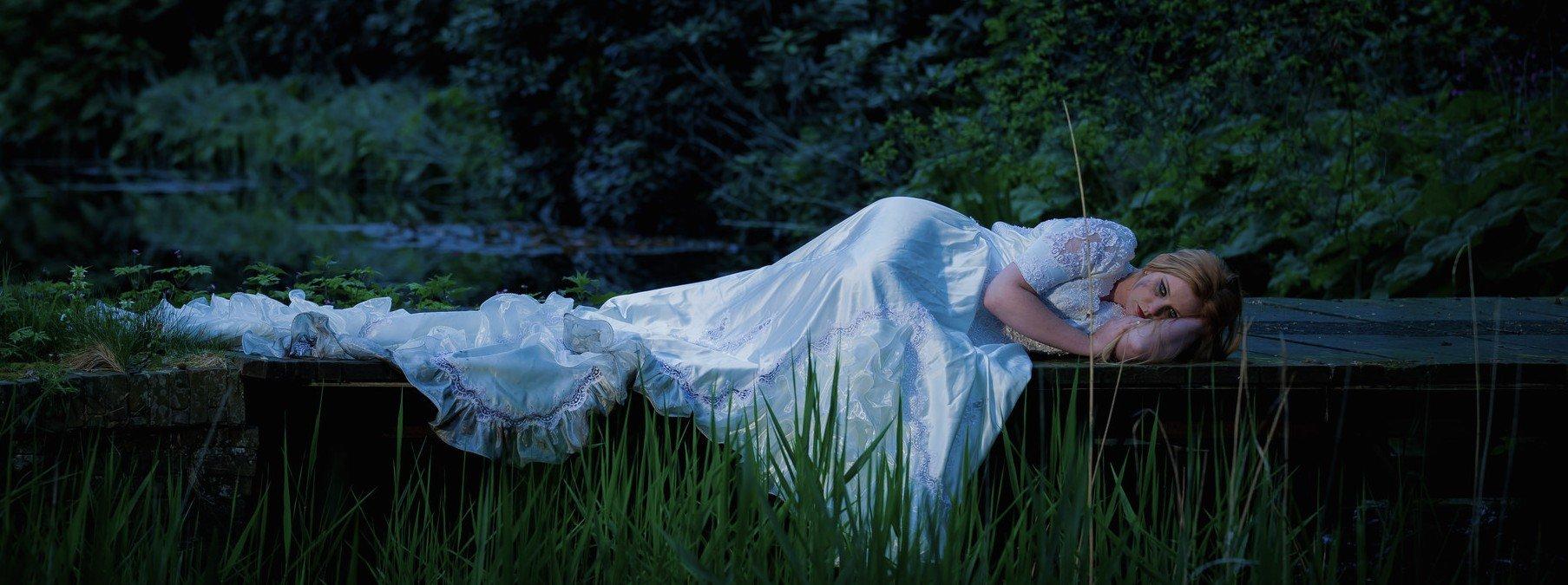 Woman sleeping in grass